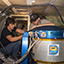 Researchers check out the Doppler Aerosol Wind Lidar (DAWN) instrument aboard a DC-8 airplane